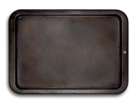 使用される陶器マークと白で分離された空のベーキング トレイ