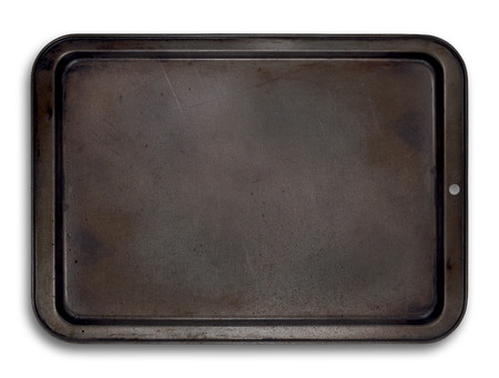 Empty baking tray isolated on white with used ware marks Reklamní fotografie