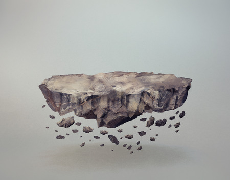 A levitating rock, with crumbling bits Stockfoto