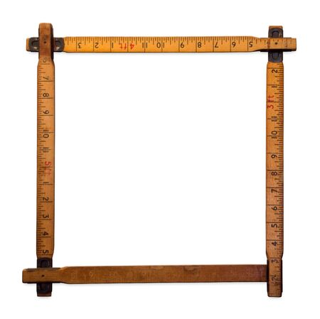 inches: A wooden rulers making a border on it isolated on a white background, Ruler Border in inches Inches frame made of wood as a retro frame