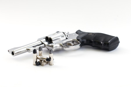 38: chrome gun  38 mm and bullets white background