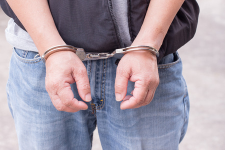 Man tied up in handcuffs