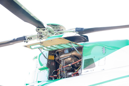 maintaining: Engineer maintaining a helicopter Engine