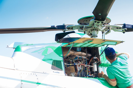 helicopter pilot: Engineer maintaining a helicopter Engine