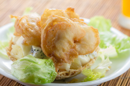 Shrimp with salad and sauce photo