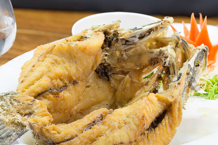dish disk: Deep fried white seabass topped fish sauce