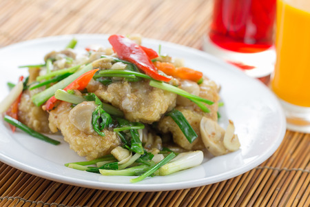 Thai food. deep fried fish stir with sweet sauce and celery Imagens - 38530371