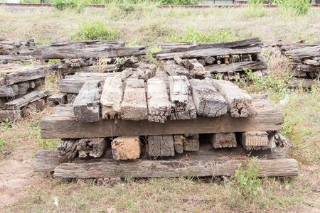 wood railways: Stacked old and weathered disassembled wooden railway sleepers
