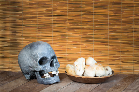 expire: Skull and Mould on food. Bread with mildew. Rotten food, bread, expire date. Stock Photo