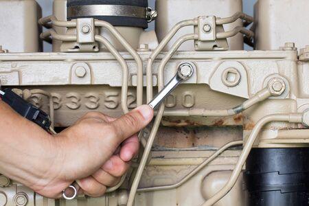 mot: Closeup of an auto mechanic working on a Generator power engine Stock Photo