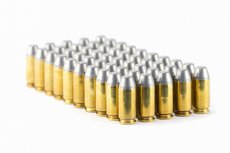 45 caliber: .45 acp semiwadcutter bullet isolated on a white background stack focus