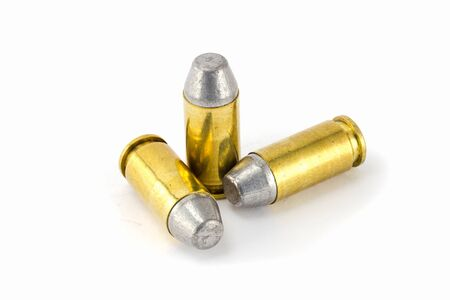 45 ammo: .45 acp semiwadcutter bullet isolated on a white background stack focus