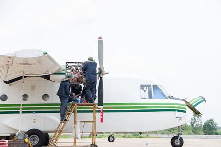 maintaining: Engineer maintaining Engine Airplane Stock Photo