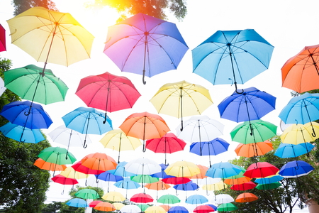 hanging colorful umbrellas background. Colorful umbrellas in the sky. Street decoration. Banque d'images