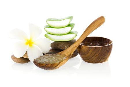 neutralize: aloe vera gel spa for use in skin care on wooden spoon with aloe vera on wooden table Stock Photo