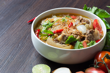 Oxtail soup, halal food, delicious, Muslim food in white bowl on dark brown wooden plate  Selective focus