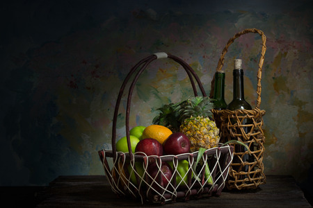 Still life of fruit  on wooden and paint wall lighting from windows