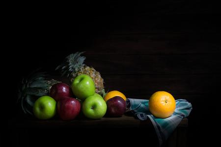 Still life of fruit  on wooden lighting from windows
