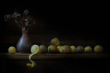 Still Life of Lamon on wooden table background