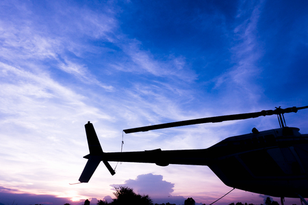 beautiful landscape with helicopter silhouette sunset light