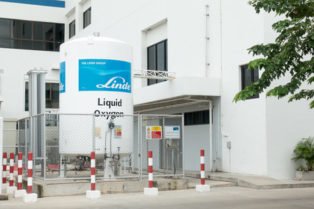 KHONKAEN, THAILAND - SEPTEMBER 14, 2017: Liquid oxygen tank in hospital with warning label for flammable