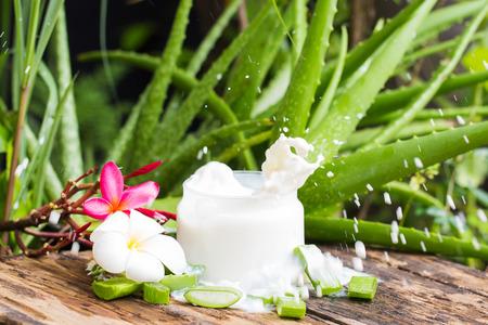Aloe vera Fresh drop on Milk splash motion blur, old wood and Blur Aloe vera plant background