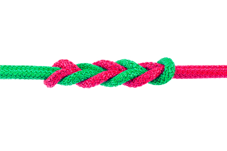 Red and Green string knotted Isolate on white background with Clipping path. Stock Photo