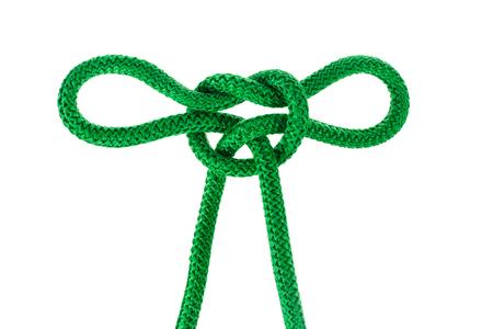 クリッピング パスを持つ白い背景に結ばれた緑の文字列を分離します。