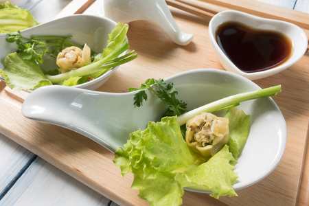 Chinese dim sum Shumai - Steamed  groumet cuisine with the dough gathered at the top. Stock Photo