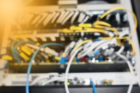 Blurred background. Fiber optical in network rack cabinet 写真素材