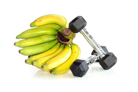 Fitness dumbbells with banana isolated on white background