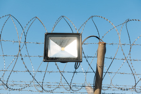 LED lamp and barbed wire.
