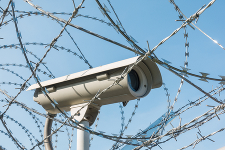 surveillance protection camera and barbed wire 写真素材
