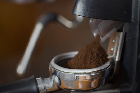 coffee grinder grinding freshly roasted make beans into a powder