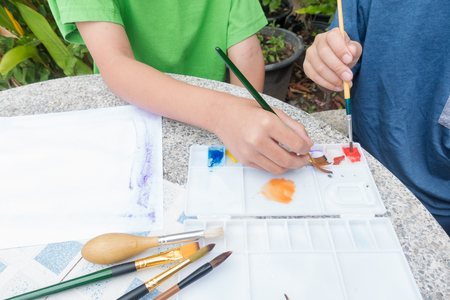 little cute boy painting with water color, lifestyle people concept