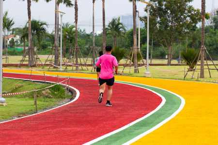 Exercise Run on Colorful Track Red, Yellow and Green with White line Imagens - 103038648