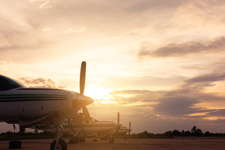 beautiful landscape image with old wing airplane at sunset 写真素材