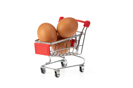 Eggs isolated in shopping cart on white background