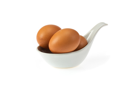 Eggs isolated in spoon on white background Imagens - 108410939