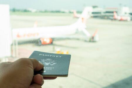 Man holding passports at airport waiting the flight