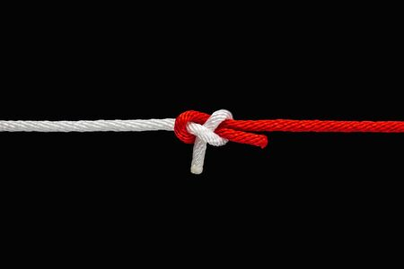 Tie the knot with red and white rope on black background with clipping path 写真素材 - 136726029