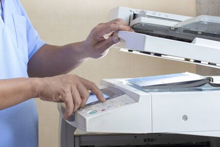 man hands copying on print device machine
