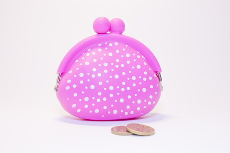 coin purses: pink purse with white polka dots on a white background with coins