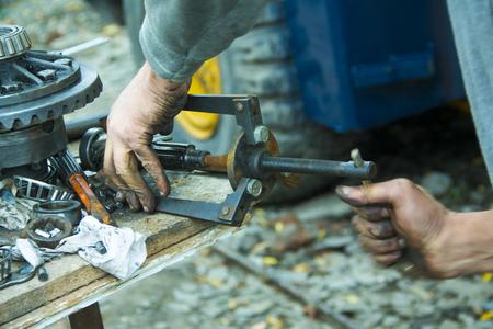 dirty car: dirty car mechanic hands examining car automobile at repair service station