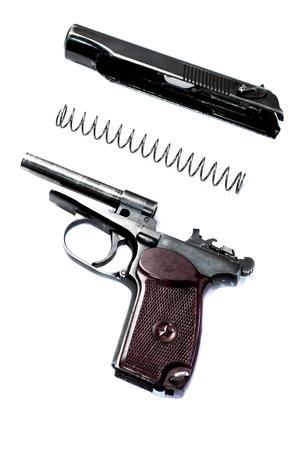 marksmanship: makarov system pistol disassembled isolated on white background