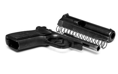 9mm ammo: makarov system pistol disassembled isolated on white background