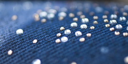 Luxury fashion background, texture jeans with rhinestones, top view Stock Photo