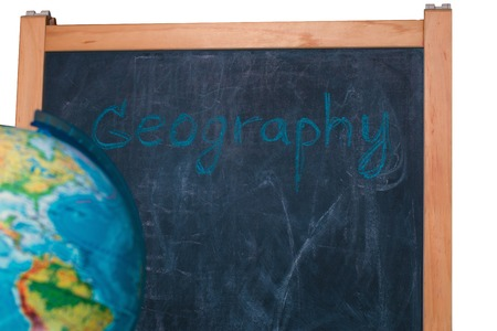 globe on the background of the school board for drawing with chalk