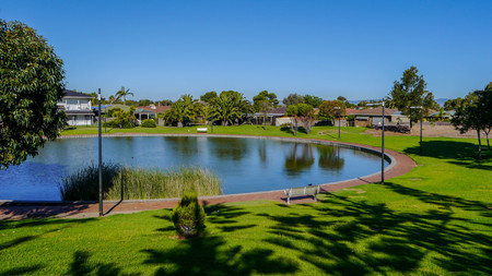 park with beautiful trees on the bank of the channel south of Adelaide in Australia in January 2017. Mural Stock Photo