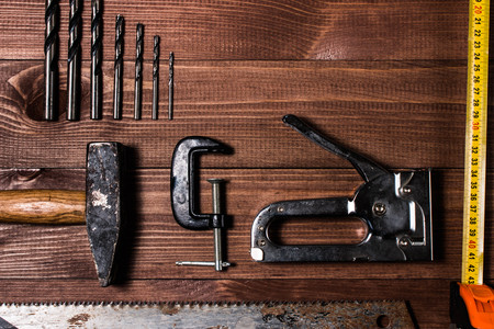 Set of hand tools on a wooden table Stock Photo
